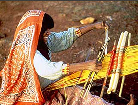 Huichol woman weaving.